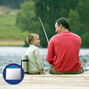 a father and a son fishing - with Wyoming icon